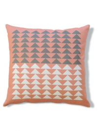 Pink pillow with white and grey triangles