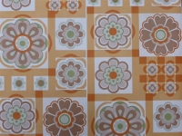 orange brown flowers in a geometric pattern