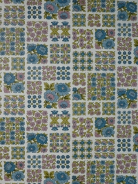 Vintage floral wallpaper with small blue and pink flowers