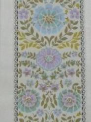 blue purple flowers in 3 lines