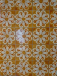 Shiny vintage orange floral wallpaper